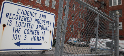 A sign points to the Evidence and Recovered Property entrance, located around the corner, at the Chicago police department's Homan Square property. (photo: Chandler West/The Guardian)