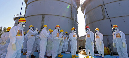 Workers at Fukushima nuclear plant. (photo: Getty/AFP)