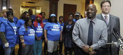 Protesters stand behind Floyd Dent as he speaks to the media. (photo: Clarence Tabb Jr/AP)