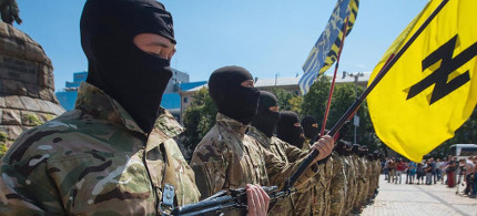 Paramilitary troops in Ukraine holding Neo-Nazi Wolfsangel (Wolf's Hook) symbol banner. (photo: BBC)