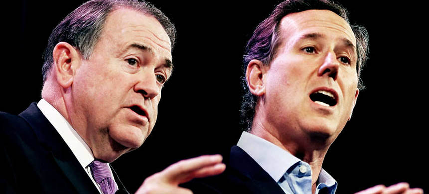 Rick Santorum and Mike Huckabee. (photo: Scott Olson/Getty Images)
