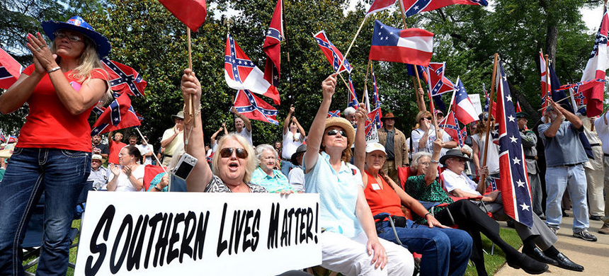Supporters gather for a rally to protest the removal of the flags from the Confederate Memorial Saturday, June 27, 2015, in Montgomery, Alabama. (photo: Julie Bennett/AL.com)