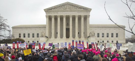 Demonstrators rally outside the Supreme Court in early March during oral arguments on the healthcare law. (photo: Pablo Martinez Monsivais/AP)