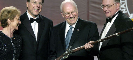 Dick Cheney accepts a rifle presented by the National Rifle Association at its annual meeting in Pittsburgh. (photo: Matt Freed/PG)