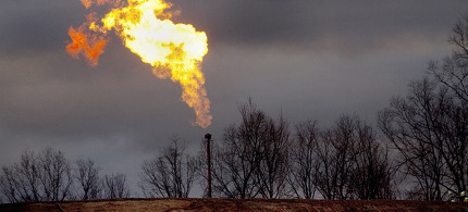 A gas flare burns at a fracking site in rural Bradford County, Pennsylvania on January 9, 2012. (photo: Les Stone/Reuters)