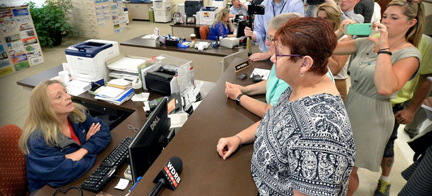A same-sex couple is denied a marriage license in Rowan County, Kentucky. (photo: Timothy D. Easley/AP)