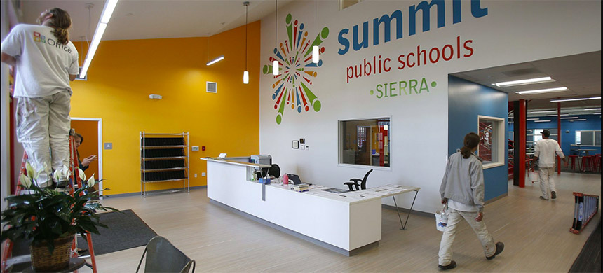 Employees of Washington Commercial Painters retouch the interior at the Summit Sierra charter school in Seattle after hours Friday. After nearly a year of deliberation, the state Supreme Court ruled late Friday afternoon that charter schools are not constitutional. (photo: Sy Bean/The Seattle Times)