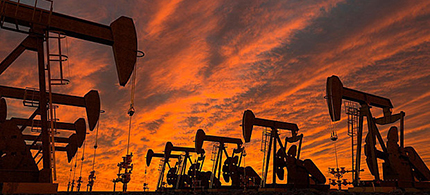 Field of pump jacks at sunset. (photo: Alamy)