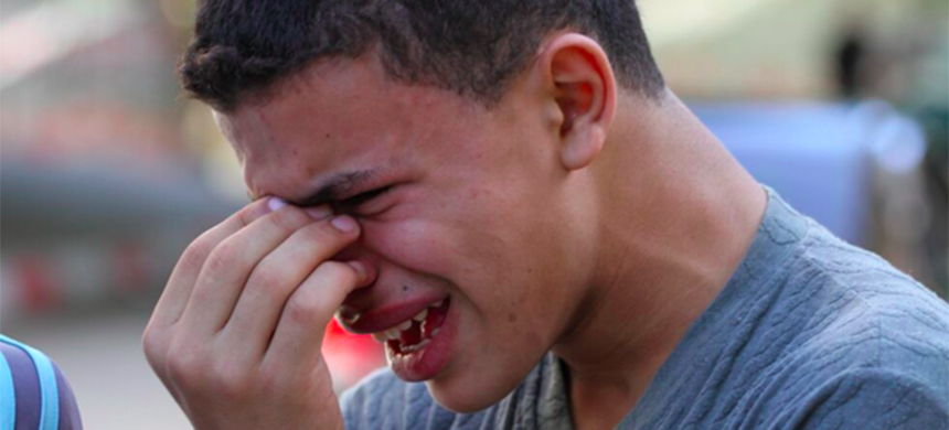 A young protester cries after clashes on the Gaza border. (photo: Mohammed Asad/MEE)