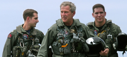 President Bush, wearing his flight suit, walks on the flight deck of the aircraft carrier USS Abraham Lincoln after arriving via a US Navy S-3B Viking Thursday, May 1, 2003, in the Pacific Ocean. (photo: Khue Bui)