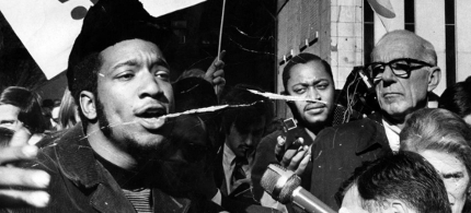 Fred Hampton, left, the head of the Illinois Black Panthers rallies with others against the trial of eight people accused of conspiracy to start a riot at the Democratic National Convention. The rally was held outside the Federal Building on Oct. 29, 1969. Editors note: There is damage to this historic print. (photo: Don Casper/Chicago Tribune)