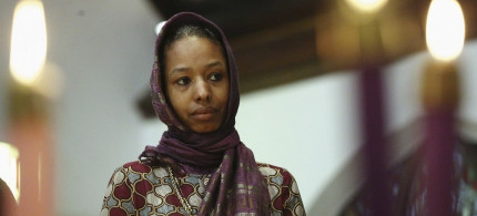 Larycia Hawkins, a Christian, and an associate professor of political science at Wheaton College, a private evangelical school in Wheaton, Ill., wears a hijab at a church service in Chicago. (photo: Stacey Wescott/Chicago Tribune/AP)