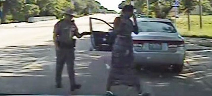 Trooper Brian Encinia forces Sandra Bland from her car after threatening to 'light her up.' Ms. Bland later died while under police custody. (photo: Reuters)