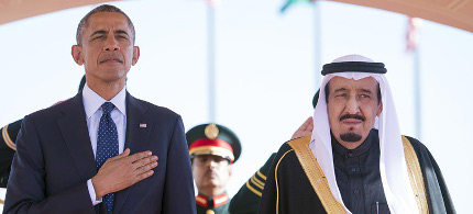President Barack Obama and Saudi Arabian King Salman bin Abdul Aziz stand during the arrival ceremony in Riyadh, Saudi Arabia, Tuesday, Jan. 27, 2015. (photo: AP)