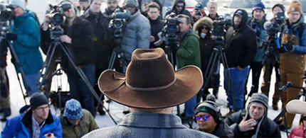 Jan. 6, 2016: Ammon Bundy in possession, along with his armed supporters, of the Malheur National Wildlife Refuge building near Burns, Oregon holds court with reporters. (photo: Rick Bowmer/AP)