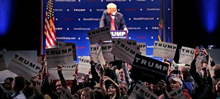 Supporters turn to show their support as a protestor interrupts an address by Republican presidential candidate Donald Trump during a campaign stop at the Flynn Center of the Performing Arts in Burlington, Vt., Thursday, Jan. 7, 2016. (photo: Charles Krupa/AP)