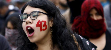 A demonstrator with the number 43 written on her face, symbolizing the 43 students who were kidnapped on September 26, 2014 in Iguala, Guerrero. (photo: Reuters)