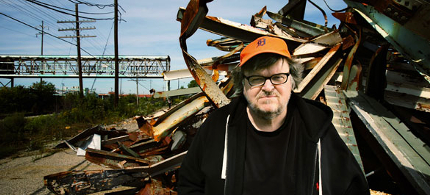 Filmmaker Michael Moore near a closed factory in Flint, Michigan, where his father worked. (photo: Fabrizio Costantini/NYT)