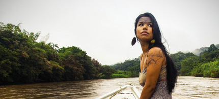 Nina Gualinga, an international activist on indigenous rights, traveling on a river through the Amazon. (photo: Caroline Bennett/Amazon Watch)