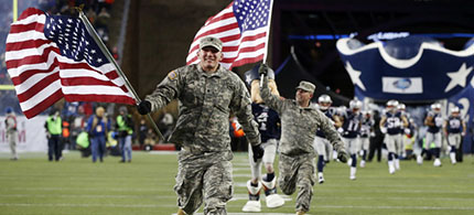 The Department of Defense paid for tributes that are part of the NFL's 'Salute to Service,' such as this one before a 2013 game between the New England Patriots and Denver Broncos. (photo: Elise Amendola/AP)