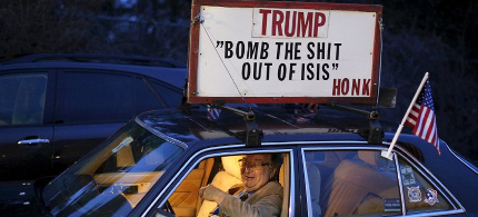 Donald Trump supporter rides in his car. (photo: Reuters)