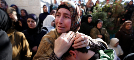 Palestinian relatives mourn during the funeral of Muhammad Mubarak, 21, in the Jalazoun refugee camp near the West Bank city of Ramallah. (photo: Mohamad Torokman/Reuters)