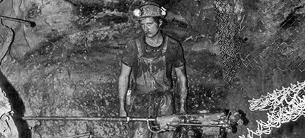 A worker drills for uranium in Church Rock Mine, New Mexico, circa 1980. (photo: Post '71 Uranium Workers Committee)