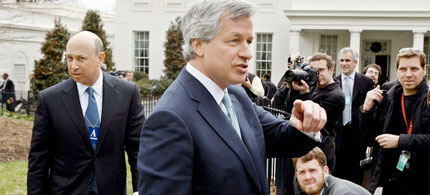 Goldman Sachs CEO Lloyd Blankfein, and JP Morgan Chase CEO James Dimon, center, leave the White House, 03/28/09. (photo: Getty Images)