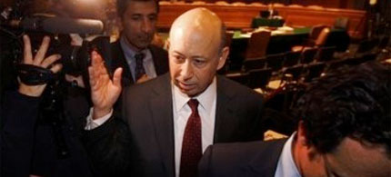 Goldman Sachs Chairman and CEO Lloyd Blankfein pushes a camera lens away as he finishes testimony before the Senate, 04/27/10. (photo: AP)