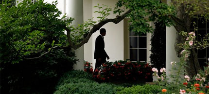 President Barack Obama walks toward the Oval Office after arriving from an overnight trip to the Gulf Coast, 06/15/10. (photo: Getty Images)