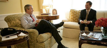 Future Supreme Court Justice John G. Roberts meets with George W. Bush in the Oval Office, 06/15/05. (photo: Eric Draper)