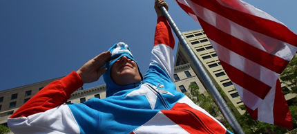 Jim Griffin, dressed as Captain America, joins conservatives participating in a Tea Party protest in Washington, DC, 4/15/10. (photo: Getty Images)