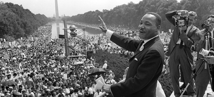 Martin Luther King Jr. waves to supporters from the steps of the Lincoln Memorial in Washington, DC during his 'I Have A Dream' speech,  08/28/1963. (photo: AFP)