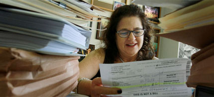 April Charney, a lawyer at Jacksonville Area Legal Aid in Jacksonville, Florida, says the foreclosure courts do not give borrowers a serious hearing. 'You get a five-minute hearing. It's a factory.' 09/04/10. (photo: Kelly Jordan/NYT)