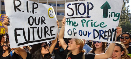 Students protest the system of for-profit higher education in the U.S. (photo: David McNew/Getty Images)