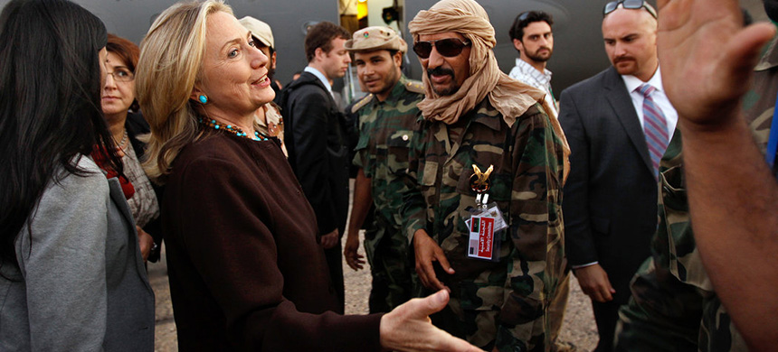 Secretary of State Hillary Clinton at the end of a one-day trip to Tripoli, Libya, on Oct. 18, 2011, after the fall of Col. Muammar el-Qaddafi. Media reports referred to it as a 'victory lap.' (photo: Kevin Lamarque/NYT)