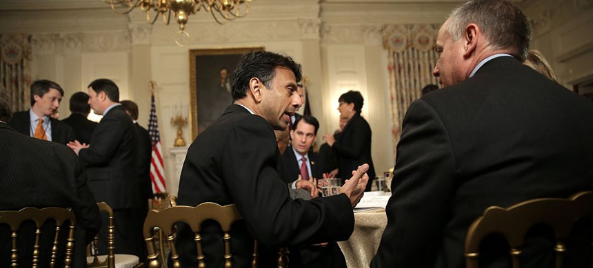 Louisiana Gov. Bobby Jindal talks with fellow state governors before President Barack Obama addressed members of the National Governors Association at the White House in 2015. Also pictured is Wisconsin Gov. Scott Walker. (photo: Win McNamee/Getty Image)