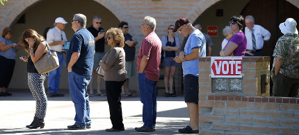 Voters wait in line to cast their ballots in Arizona's presidential primary election on March 22 in Gilbert, Arizona. (photo: Matt York/AP)