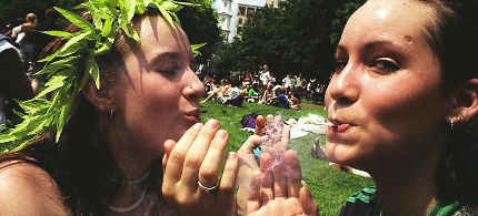 Protesters share a joint. (photo: Shawn Thew/Getty Images)