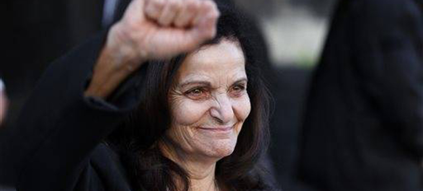 Rasmea Odeh raises her fist as she leaves federal court in Detroit Thursday, March 12, 2015. (photo: AP)