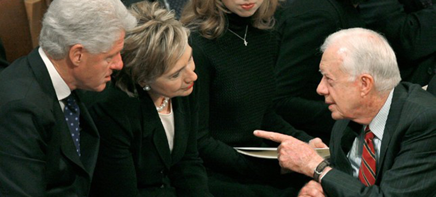 The Clintons with former President Carter. (photo: Getty Images)