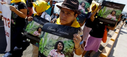 An Indigenous woman holds a poster with a photograph of Berta Caceres during a march to demand justice in Tegucigalpa, Honduras. (photo: Reuters)
