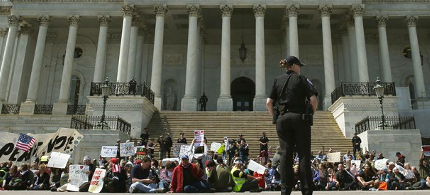 Democracy Spring protesters participate in a sit-in at the U.S. Capitol to protest big money in politics, April 11, 2016, in Washington, D.C. (photo: Mark Wilson/Getty Images)