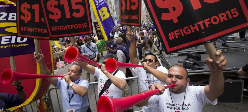 People celebrate the passage of the minimum wage increase for fast-food workers. (photo: AP)