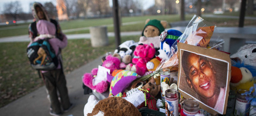 Kiara Jacobs, 8, hugs her brother Quentin Stamen, 13, at a memorial in the Cleveland park where Tamir Rice was fatally shot by police officers. (photo: Ty Wright/NYT)