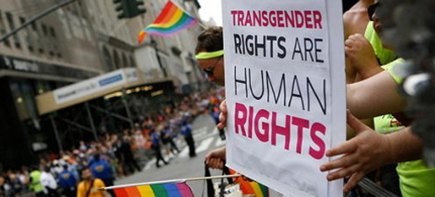 A demonstrator holds a sign at a transgender rights rally. (photo: National Center for Transgender Equality)