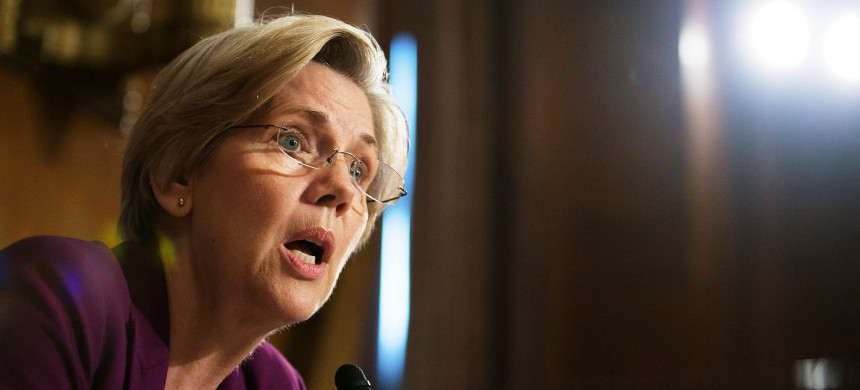 Sen. Elizabeth Warren (D-MA) questions witnesses during a Senate Banking, Housing and Urban Affairs Committee hearing on