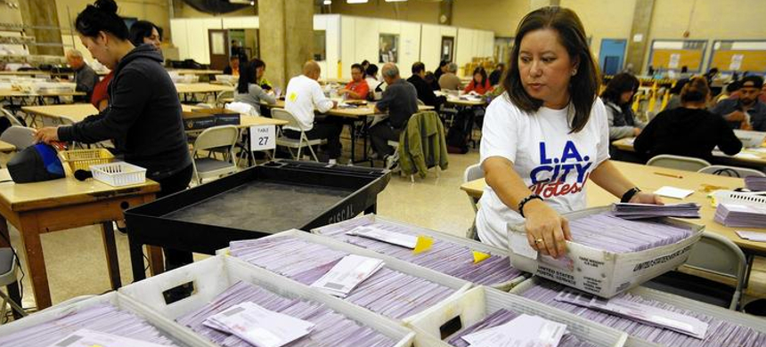L.A. officials sort uncounted ballots from the Los Angeles primary election. (photo: Genaro Molina/LA Times)