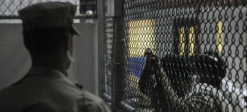 Guantanamo Bay prisoners. (photo: Joshua Nistas/Reuters)