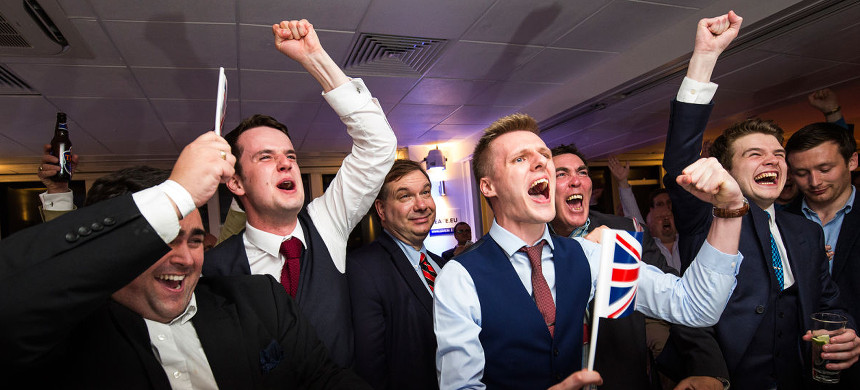 Men celebrate the result of last night's referendum on the UK leaving the EU. (photo: Bjack Taylor/Getty)